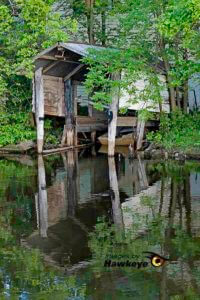 Mirror images - an old boat house.