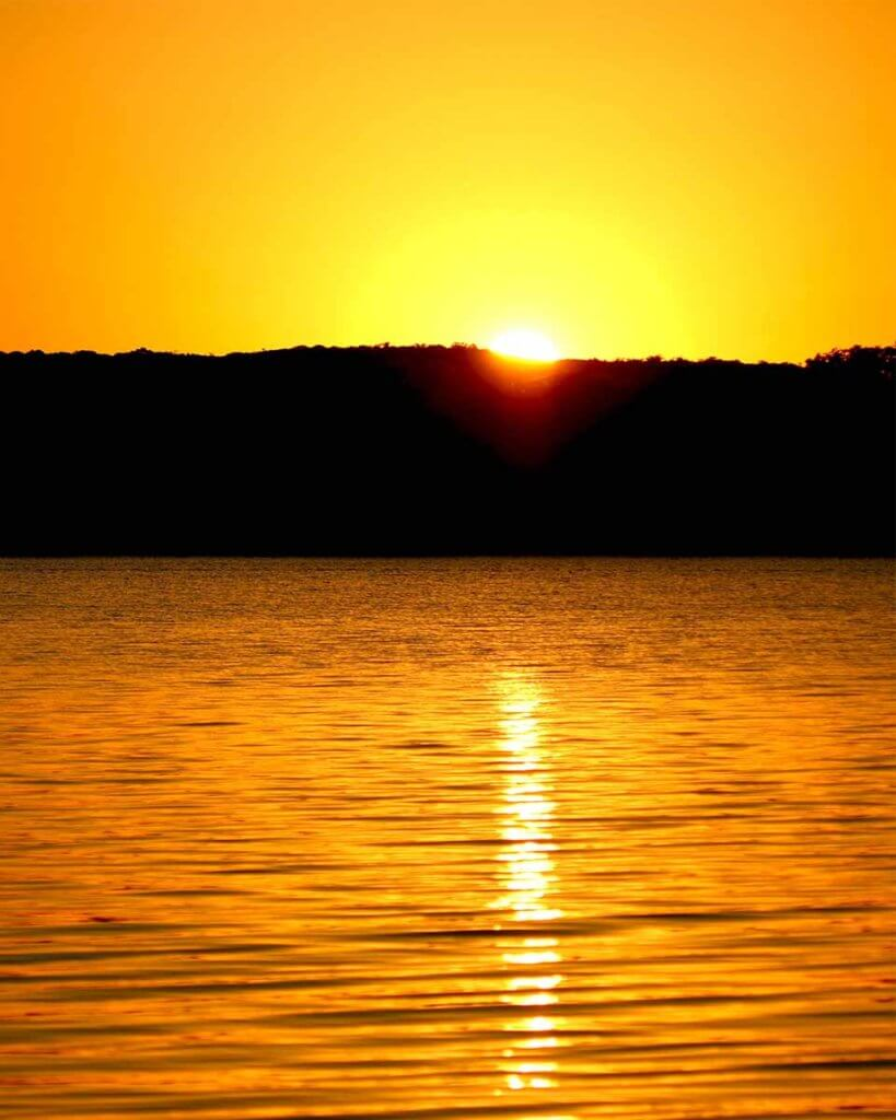 sunsetting over a lake.